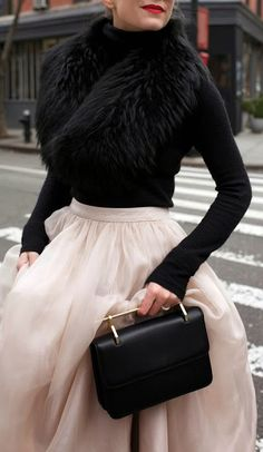 Skirt: Alice + Olivia. Black Turtleneck. Bag: M2M. Shawl: Otte. Sunglasses: Karen Walker 'Super Duper'. Lips: Stila 'Beso'.