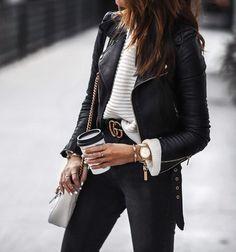 white sweater, black moto jacket, skinny jeans, statement belt