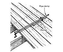 Straightening warped deck boards