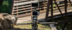 """SLD-31   The slider's camera platform allows for different mounting options. The wide camera  platform makes leveling cameras easy. A 3/8""""-16 thread mounts a flat fluid head."""