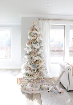 Whimsical Glam Christmas Living Room In Pastels - Summer Adams Christmas Tree Feathers, White Flocked Christmas Tree, Pink Christmas Tree Decorations, Christmas Tree With Snow, Blue Christmas Decor, Christmas Living Rooms, Christmas Tree Design, Beautiful Christmas Trees, Christmas Mantels