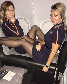 Two Female Flight Attendants in black dress & black pantyhose Pantyhose Outfits, Black Pantyhose, Black Tights, Pantyhose Heels, Flight Attendant Hot, Cool Tights, Pernas Sexy, Pantyhosed Legs, Athletic Women