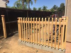 Build a fence using cinder blocks as the base. All the wood was purchased and cut to fit using a saw. Posts cemented into the cinder block. Wood is being stained and cinder blocks painted to match the patio color. Cinderblock Fence, Patio Fence, Pallet Fence, Diy Fence, Metal Fence, Fence Ideas, Yard Fencing, Aluminum Fence, Yard Ideas