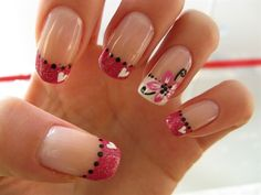 Pink, black and white french tip with a flower and hearts.