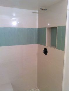 sheet tile for showers. 12 x24  Polished Porcelain tile with 4 x16 glass accent porcelain sheet halved for trim 1 x1