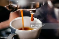 Espresso Shot Pouring Out Stock Photo | Getty Images