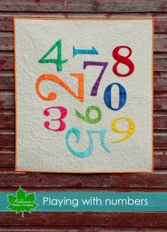Bright and fun baby quilt with numbers. Modern play or baby quilt pattern for a fast and easy quilt to make for your nursery or baby shower gift.