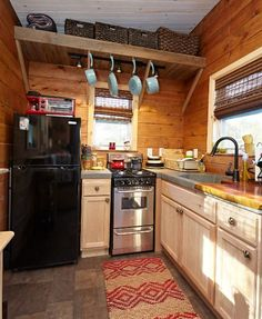 This tiny home's kitchen features a geometric sink.