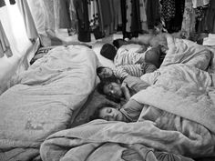 Syrian children sleeping inside their family's tent in the Bekaa Valley, #Lebanon. As the war drags on, the camps are becoming more cramped. Moises Saman/Save the Children