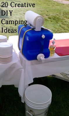 20 Creative DIY Camping Ideas - I think I have several of these pinned already, but I really like the bungee cord for the paper towels - genius!  And the empty bucket below to keep from making a messy puddle below your hand washing station. #camping #summerfun #freezercooking