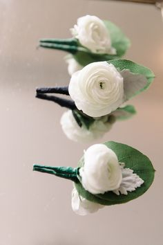 Ranunculus Boutonniere: http://www.StyleMePretty.com/2014/03/10/new-haven-lawn-club-wedding/ Photography: Michelle Lange