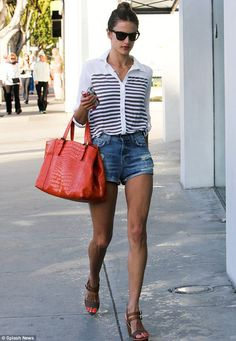 You turned what age? Alessandra Ambrosio marked her 32nd birthday by wearing a pair of tiny denim shorts and a white and navy shirt as she headed out in Beverly Hills on Wednesday