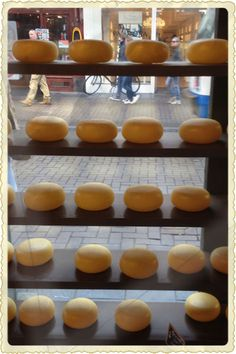 Wax-encased rounds of handmade gouda are displayed like jewels at Henri Willig Cheese and More on the pedestrian shopping street, Leidsestraat, in Amsterdam.