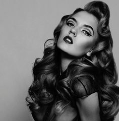 Very 40's pin up (reminiscent of Rita Hayworth with the updated winged eyes) with long and wavy tresses...Beautiful!