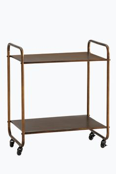 Hylly, jossa pyörät. Sopii sivupöydäksi, tarjoiluvaunuksi, kylpyhuoneeseen jne. Kaksi hyllytasoa. Metallia. Koko 60x40 cm. Korkeus 70 cm. Hyllyjen välinen etäisyys 44 cm. Toimitetaan osina. <br><br> Kitchen Cart, Wardrobe Rack, Wine Rack, Living Spaces, Interior, Table, House, Furniture, Home Decor