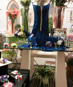 Our 2013 Navy Blue Dress Display Showing Off Not Only Our Varying Shades & Styles Of Blue Wrist Corsages & Boutonnieres, But Also A Variety Of Other Colors, Including Whites, Pinks, & Lavenders