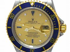 Gents Rolex 18K Gold & Stainless Steel Oyster Perpetual Submariner Watch. Champagne Serti Dial. 18K Yellow Gold Bezel blue insert. 18K Gold & Stainless Steel Oyster Band. Style 16613.   Metal:  TWO-TONE  Order Item:  30573  Style:  SUBMARINER  Gender:  GENTS  Band:  TT OYSTER  Dial:  CH SERTI  Bezel:  BLUE  Crystal:  SAPPHIRE  Movement:  AUTO  List Price:  $11,700  Our Price: call for price