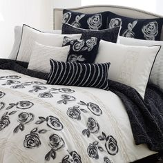 Steve Madden Camille bedding brings a designers touch into your bedroom. The contrasting black and white design adds a sophisticated and stylish sensibility to the decor of any bedroom. Black embroidered flowers sit on top of the white ground. Sections of gathered pleats stretching east/west over the comforter add texture and value. Take the style of your bedroom to new heights with the Steve Madden Camille bedding set. Starting at $19.99