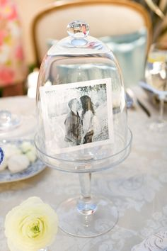 Photo in Glass Dome Display for Decoration   Photography: Steve Steinhardt. Read More: http://www.insideweddings.com/weddings/parisian-inspired-bridal-shower-in-southern-california/488/