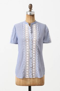Take a too small shirt and add lace to front and sleeves. Might work!