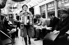 Old black & white photos of scene on the New York subway by Ralph Crane from 1969