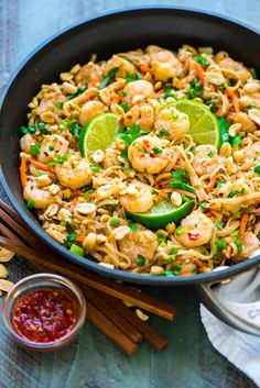 Healthy Shrimp Pad Thai. A light version of everyone's favorite take out dish that's so easy and delicious! Ready in 15 minutes and gluten free.