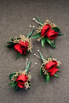 Red rose boutonnière with gold seeded accent. Contact Marion at Bayview Florist Wedding Studio in Sayville, NY. Maz851@aol.com