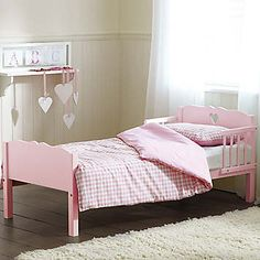 The Saplings Heart Junior bed offers a subtle decorative motif coupled with sturdiness that makes this bed last for years. This bed is a great solution for those parents looking for a bed once their child is out of a cot, but feel they're not quite at the stage where they require a full size single bed. Compared to a standard single bed, the junior bed is lower for easier access and also features removable bed guards on either side.  Brand: Saplings  Measures 143W x 72D x 60H cm (56¼ x 28¼…