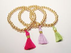 A Pack of Golden Beads Bracelet with Pink Green and by itsamyu