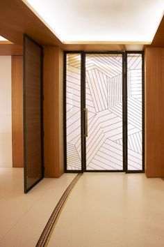 Frosted vinyl with a printed pattern can look gorgeous and provide privacy! | Hôtel Maison FL 's renovation by François Champsaur