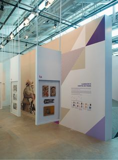 exhibition with a signage and printed pieces created by the Brazilian studio Campo.