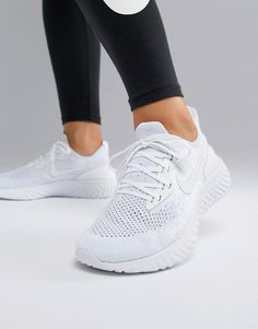 Buy Nike Running Epic React Trainers In White at ASOS. With free delivery and return options (Ts&Cs apply), online shopping has never been so easy. Get the latest trends with ASOS now. Girls Sneakers, Girls Shoes, Sneakers Nike, White Nike Shoes, White Nikes, Nike Running, Running Shoes, Running Women, Track And Field Shoes