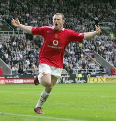 Wayne Rooney of Manchester United celebrates scoring the first goal during the Barclays Premiership match between Newcastle United and Manchester United at St James' Park on August 28 2005 in. Get premium, high resolution news photos at Getty Images John Peter, St James' Park, Wayne Rooney, Man United, Manchester United, Scores, The One, Newcastle England, August 28