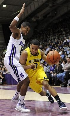38 Three-Pointers and an overtime later, Trey Burke (scoring 19 points) and the Michigan Wolverines win over Northwestern 67 - 55.