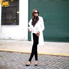 Click the photo to shop the look | Kat of With Love From Kat wearing a Tahari winter white coat, black legging pants, and Jimmy Choo pumps | Follow @liketoknowit on Pinterest for more outfit inspiration #liketkit