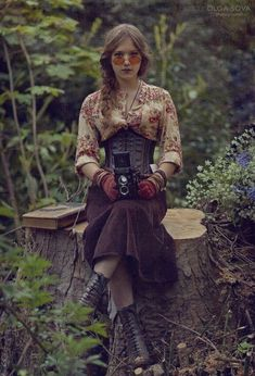 Steampunk --- That glasses, braid, gloves, shirt with 3/4 sleeves! That's my girl, that's my style :)
