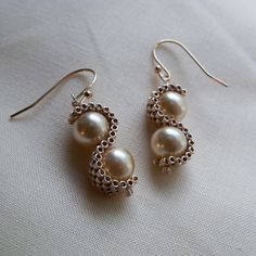 """Simple and nice - glass pearls wrapped in """"s"""" curved of peyote stitched seed beads"""