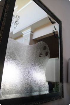 DIY ghost mirror via Krazy Coupon Lady.  Only need plastic wrap and scissors | follow and share for more