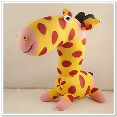 http://www.etsy.com/listing/69791898/handmade-sock-giraffe-stuffed-animal#