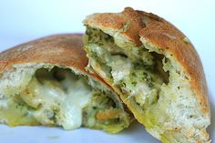 Chicken Artichoke Pesto Calzone (pizza dough, pesto, grilled chicken, canned artichockes, mozzarella, evoo)