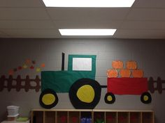 Our Tractor...I store my preschoolers seasonal arts and crafts on the trailer. We do flowers for Spring, pumpkins for Fall, and Christmas trees for Winter, etc...