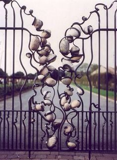 Unique iron gates designed with rocks. #iron #gates