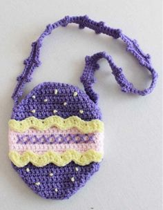 Watch Maggie review this cute Easter Purse Set Crochet Pattern! An Original Easter Purse Set Crochet Pattern Design by: Donna Harelik Skill Level: Easy Materials: Yarn Needle; Worsted Weight Yarn: Bab