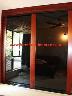 Infinity Sliding Doors with Black glass and palm motif.  Sliding Bedroom Doors