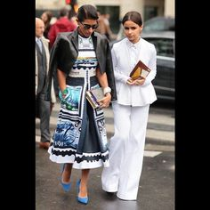 Miroslava Duma looks effortlessly chic in this all-White ensemble, which contrasts beautifully with her print-clad companion! #paris #PFW #SS16 #fashion #ootd #streetstyle #miroslavaduma #spring #summer #love #luxury #summerfashion #style #instastyle #fashiongram #fashionstyle #fashionweek #parisfashionweek