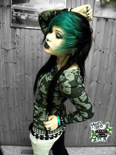 //scene style, black eyeliner and lipstick, black and green hair, piercings