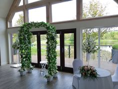 Wedding Archway and Pedestal Flower Arrangements at Forbes of Kingennie. Available to hire from www.limelightweddings.co.uk Wedding Post Box, Wedding Hire, Wedding Photos, Wedding Lanterns, Marquee Wedding, Wedding Decorations, Manzanita Tree Centerpieces, Elegant Table Settings, Cherry Blossom Wedding