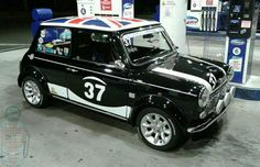 FILL IT UP FRIDAY MINI IN THE DARK time folks and this week its a beautiful Flag Waving Mini at the pumps that Our Lou spotted!