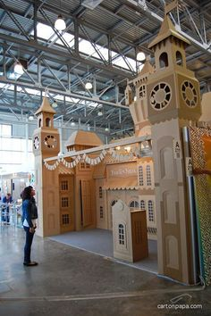 City buildings made solely out of cardboard for this creative booth!