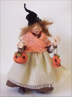 Pumpkin Witch - about 5 1/2 inches tall.
